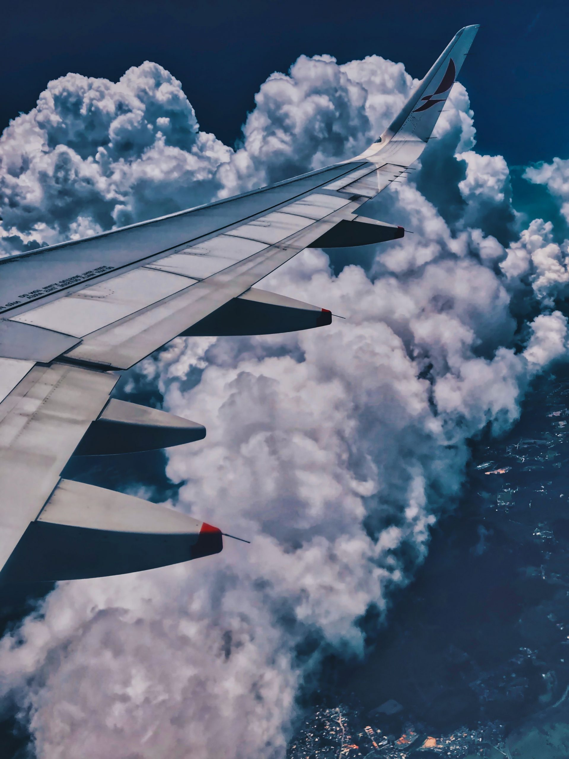 aircraft-wing-over-clouds-1815396